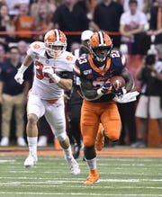 Syracuse Orange running back Abdul Adams (23) runs past Clemson Tigers defensive end Logan Rudolph (34) during the second quarter last Saturday at the Carrier Dome.