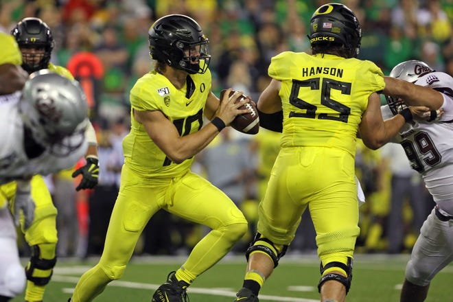 Sep 14, 2019; Eugene, OR, USA; Oregon quarterback Justin Herbert (10) steps into the pocket with help from center Jake Hanson (55) against Montana at Autzen Stadium. Mandatory Credit: Rob Kerr-USA TODAY Sports