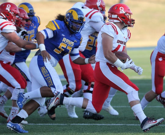 Angelo State University's Sioeli Pulu tries to tackle Simon Fraser's Tanner Nelson during a nonconference game at LeGrand Stadium at 1st Community Credit Union Field Saturday, Sept. 14, 2019.