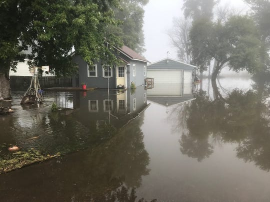 A Renner home is flooded after the Big Sioux River hits near-record heights over the weekend.