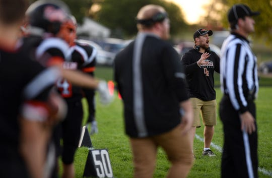 Dell Rapids football coach Jordan Huska yells to the players on the field during a home game on Friday, September 13.