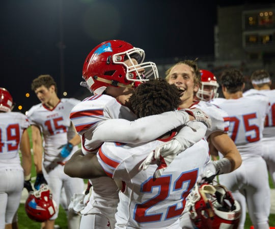 Lincoln football players celebrate a win during the President's Bowl at Howard Wood Field on Saturday, Sept. 14, 2019.