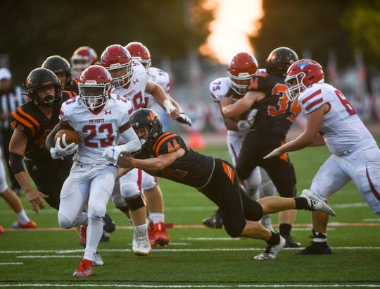 Lincoln running back Leo Kayee (23) runs the ball during the President's Bowl at Howard Wood Field on Saturday, Sept. 14, 2019.