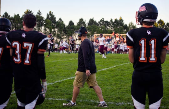 Dell Rapids football coach Jordan Huska watches a play from the sidelines during a home game on Friday, September 13.