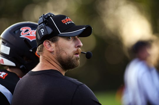 Dell Rapids football coach Jordan Huska looks back to the scoreboard during a home game on Friday, September 13.