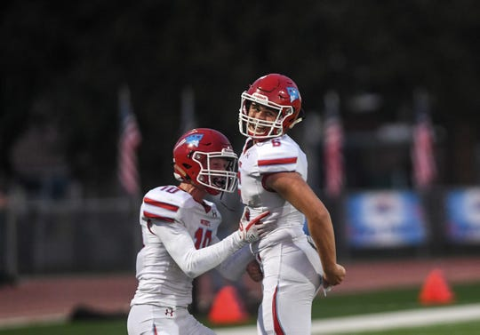 Lincoln football players celebrate a touchdown during the President's Bowl at Howard Wood Field on Saturday, Sept. 14, 2019.