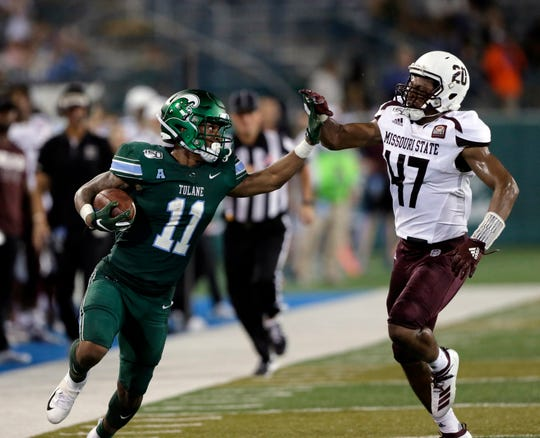 Tulane running back Amare Jones (11) fights his way past Missouri State safety Kam Carter (47) for a long gain during an NCAA college football game Saturday, Sept. 14, 2019, in New Orleans.