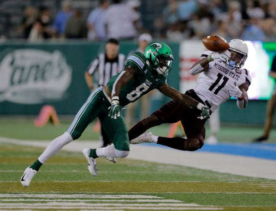 Tulane cornerback Willie Langham (8) knocks the ball away from Missouri State wide receiver Tyler Currie (11) during an NCAA college football game Saturday, Sept. 14, 2019, in New Orleans.