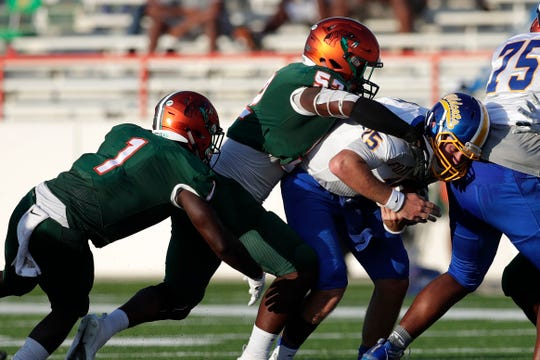 FAMU linebacker Derrick Mayweather sacks Fort Valley State quarterback Jarman Slade. The Rattlers had seven total sacks in the 57-20 win.