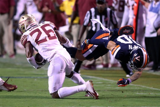 Florida State defensive back Asante Samuel Jr. (26) intercepts a pass intended for Virginia running back Billy Kemp IV (80) during the first half of an NCAA college football game in Charlottesville, Va., Saturday, Sept. 14, 2019. (AP Photo/Andrew Shurtleff)