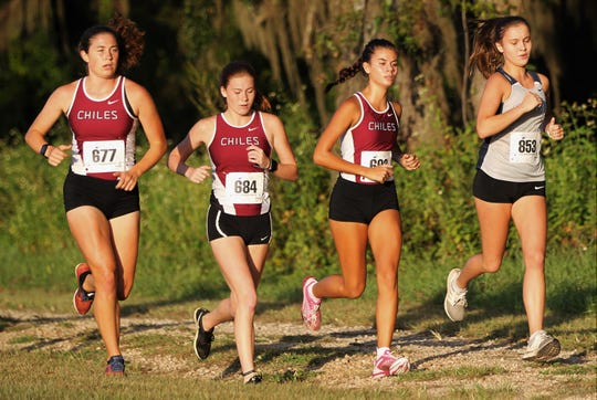 Chiles' Megan Churchill, Ella Hodges and Elise Ferguson run next to Maclay senior Rachael Stockel at the Red Hills Invitational cross country meet at Elinor Klapp-Phipps Park on Saturday, Sept. 14, 2019.