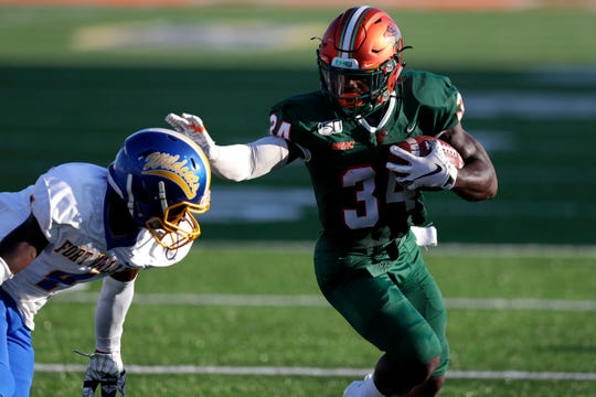 Florida A&M Rattlers running back Davonne Kendrick (34) pushes off a defender as he runs into the end zone. The Rattlers hosted the Fort Valley State Wildcats for their first home game of the season Saturday, Sept. 14, 2019.