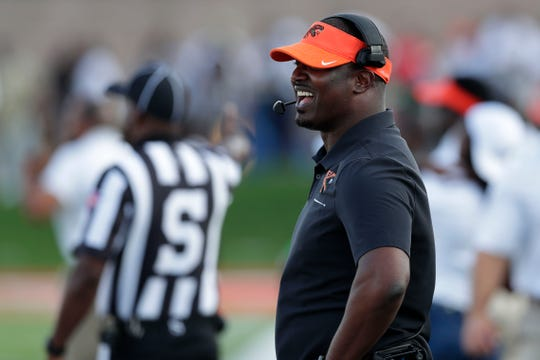 Florida A&M head coach Willie Simmons smiles after his players scored a touchdown. The Rattlers beat the Fort Valley State Wildcats 57-20 for their first home game of the season Saturday, Sept. 14, 2019.