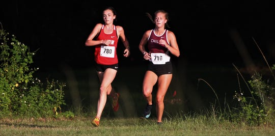 Leon junior Avery Calabro and Chiles senior Caitlin Wilkey lead during the Red Hills Invitational cross country meet at Elinor Klapp-Phipps Park on Saturday, Sept. 14, 2019.