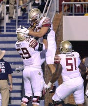 Florida State tight end Gabe Nabers celebrates a touchdown with offensive lineman Brady Scott (59) during the first half against Virginia in an NCAA college football game in Charlottesville, Va., Saturday, Sept. 14, 2019. (AP Photo/Andrew Shurtleff)