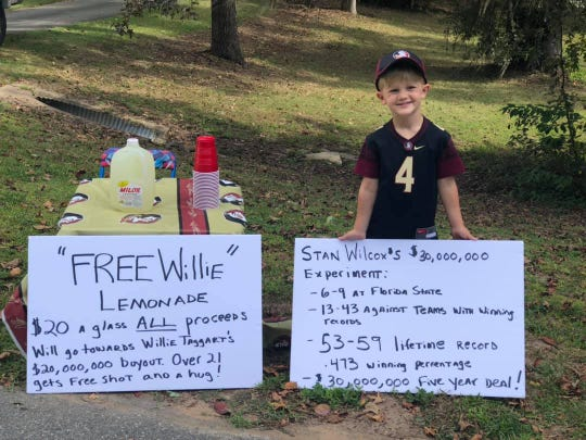 Grayton Grant, 4, set up a lemonade stand Sunday morning to help raise money to pay for FSU coach Willie Taggart's $17-million buyout.