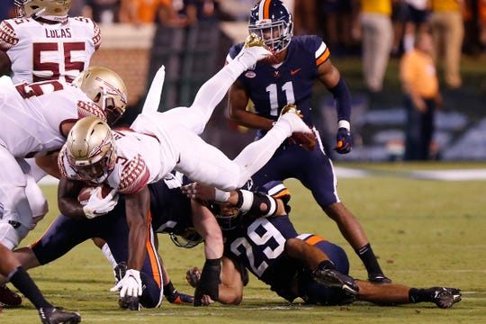 Sep 14, 2019; Charlottesville, VA, USA; Florida State Seminoles running back Cam Akers (3) carries the ball as Virginia Cavaliers safety Joey Blount (29) attempts the tackle in the first half at Scott Stadium. Mandatory Credit: Geoff Burke-USA TODAY Sports