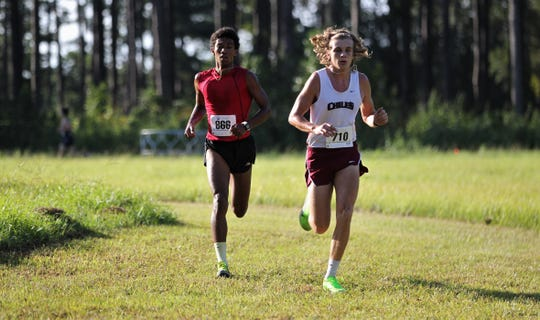 NFC senior David Keen and Chiles junior Nathan Reffitt races side by side at the Red Hills Invitational cross country meet at Elinor Klapp-Phipps Park on Saturday, Sept. 14, 2019.
