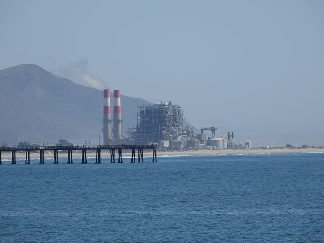 The Ormond Beach generating station in Oxnard is visible beyond the pier in Port Hueneme.