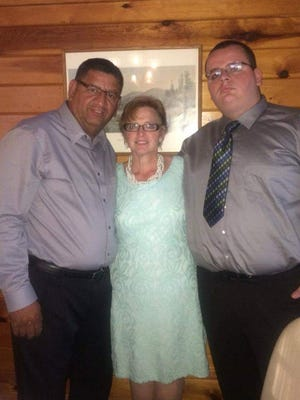Milton Santiago Sr. and Serene Santiago, pictured here in a file photo, with their son, Milton Santiago Jr., a volunteer Vineland firefighter.