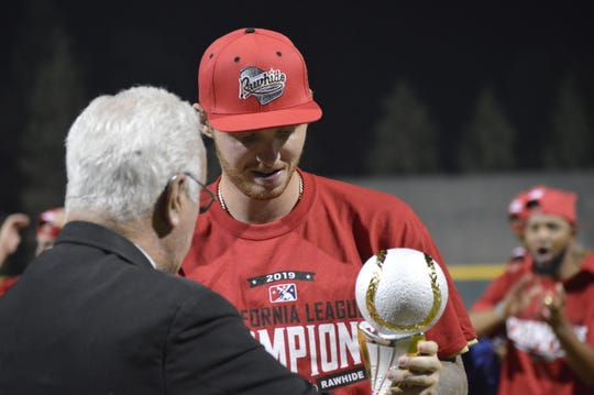 The Visalia Rawhide celebrate after winning the 2019 California League championship on Saturday night at Recreation Park.