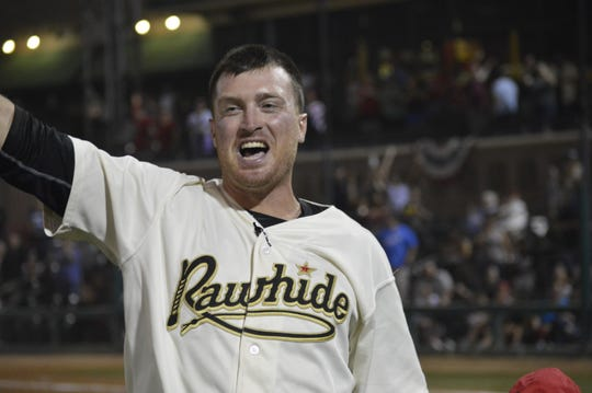 Visalia Rawhide manager Shawn Roof celebrates after winning the 2019 California League championship on Saturday night at Recreation Park.