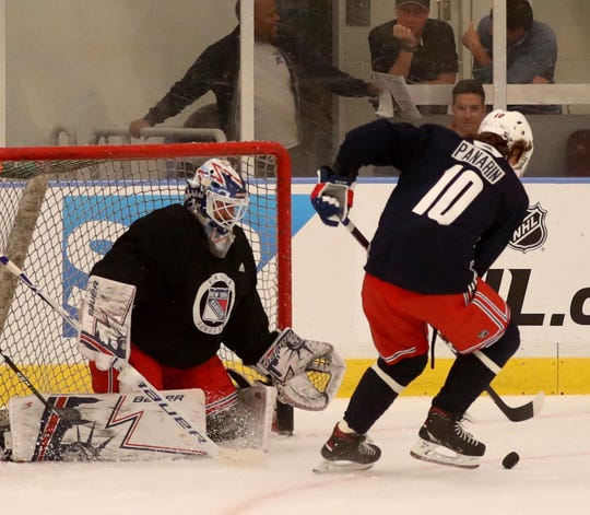 New York Rangers goalie Henrik Lundqvist in net battling Artemi Panarin during practice at the Rangers practice facility in Greenburgh Sept. 15, 2019.