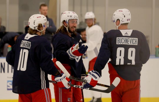 New York Rangers left wing Artemi Panarin, center Mika Zibanejad, and right wing Pavel Buchnevich during practice at the Rangers practice facility in Greenburgh Sept. 15, 2019.
