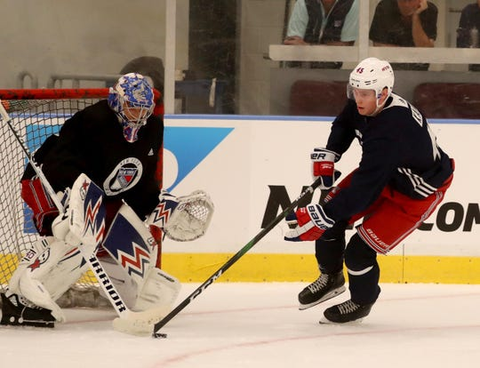 New York Rangers right wing Kaapo Kakko and goalie Alexander Georgiev during practice at the Rangers practice facility in Greenburgh Sept. 15, 2019.