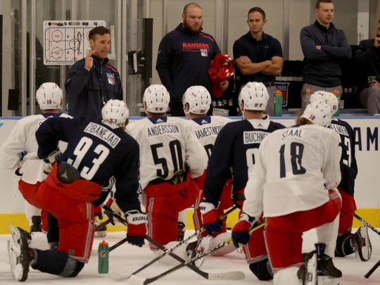 New York Rangers head coach David Quinn speaks to his team during practice at the Rangers practice facility in Greenburgh Sept. 15, 2019.