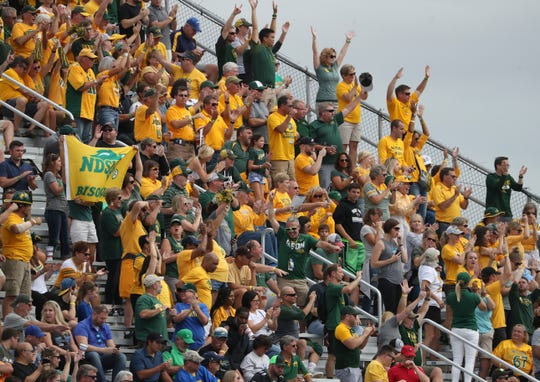 Bison fans celebrate after North Dakota State scored in the fourth quarter of Delaware's 47-22 loss at Delaware Stadium Saturday.