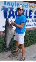 Colt Williamson of Harrington with his state-record blue catfish caught from the Nanticoke River on Aug. 31.