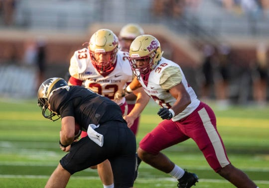 Midwestern State linebackers Rigoberto Carrillo (38) and Zack McMahen (33) converge to stop Lindenwood quarterback Cade Brister in the Mustangs' 28-27 victory Saturday, Sept. 14, 2019, at St. Charles, Missouri.