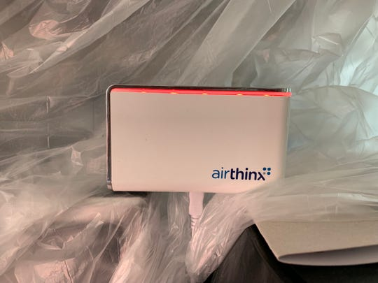 Airthinx IAQ professional-grade air quality monitor shows a red light signaling poor quality during recent renovations of the author's house in West Oakland, Calif.