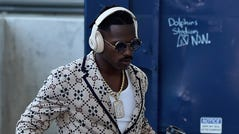 New England Patriots wide receiver Antonio Brown (17) walks into the building prior to the game against the Miami Dolphins at Hard Rock Stadium.