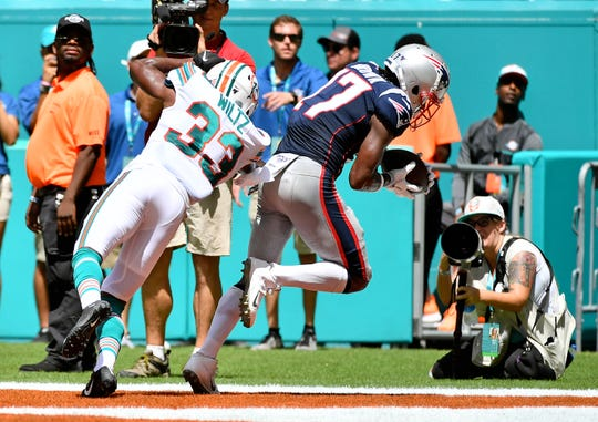 In his first game with the New England Patriots, wide receiver Antonio Brown catches a 20-yard touchdown pass from Tom Brady.