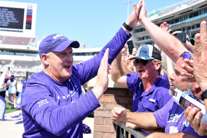 Kansas State coach Chris Klieman celebrates with fans after his team defeated Mississippi State.
