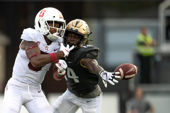 UCF Knights defensive back Nevelle Clarke defends a pass intended for Stanford Cardinals wide receiver Connor Wedington during the third quarter at Spectrum Stadium.