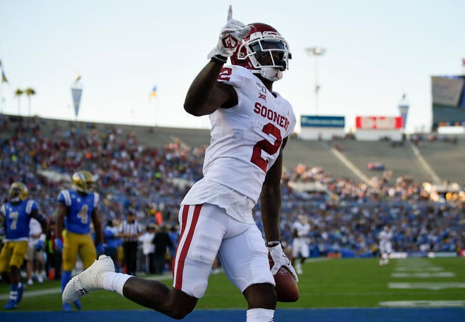 Oklahoma Sooners wide receiver CeeDee Lamb celebrates his touchdown during the first half against the UCLA Bruins at the Rose Bowl.