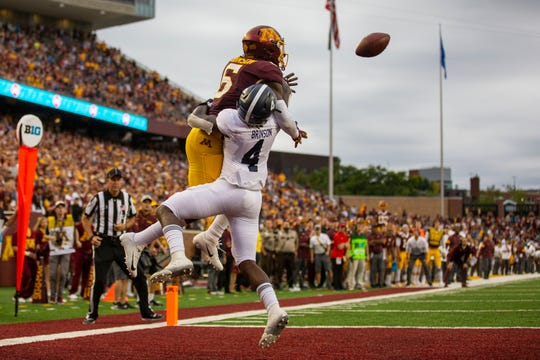 Minnesota Golden Gophers wide receiver Tyler Johnson catches a touchdown pass over Georgia Southern Eagles cornerback Monquavion Brinson in the fourth quarter at TCF Bank Stadium.