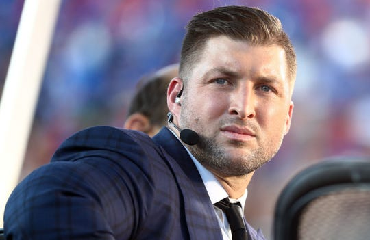 Tim Tebow before the college football season opener between Florida and Miami in August.