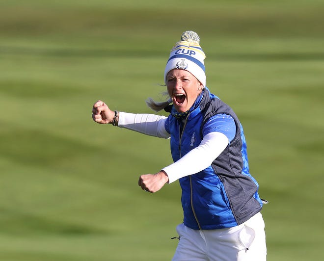 Suzann Pettersen celebrates after holing a putt on the 18th green to win the Solheim Cup for Europe.