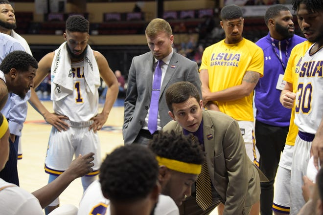 LSUA head coach Larry Cordaro coaches his team during a timeout of the 2019 NAIA Tournament first round game against Central Baptist.