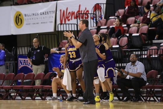 LSUA coach Bob Austin (center) helps guide the team during its 2019 NAIA Tournament First Round win over Westmont.
