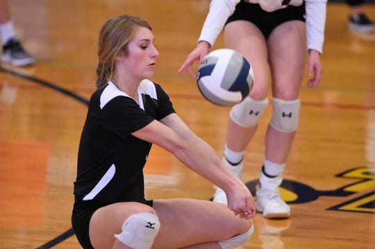 Wylie libero Pierson Sanders (1) returns a serve against Stephenville on Friday. Sanders is a leader on the Lady Bulldogs back row.