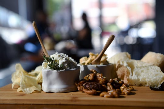 The Chips n' Dips at Rustic Grape Wine Bar features house-made pimento cheese and a savory house-made garlic and herb cheese spread served with nuts, kettle chips and ciabatta from City Bakery.