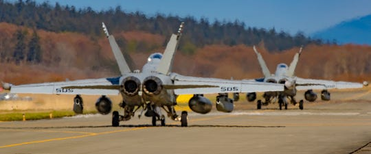 Two EA-18G Growlers from squadron VAQ-136 taxi toward the runway at Ault Field as they prepare to take off in March.