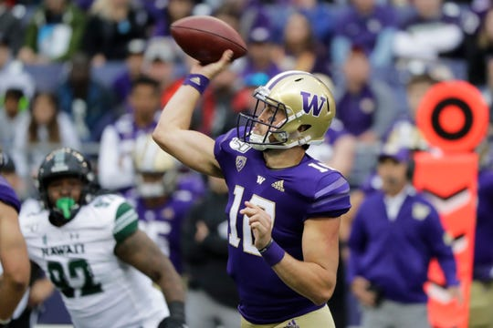 Washington quarterback Jacob Eason passes against Hawaii during the first half of an NCAA college football game, Saturday, Sept. 14, 2019, in Seattle.