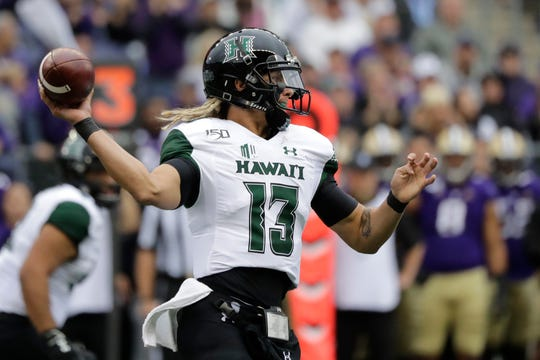 Hawaii quarterback Cole McDonald passes against Washington Saturday, Sept. 14, 2019.