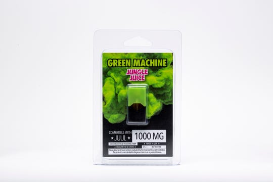 "This Wednesday, July 17, 2019, photo shows a Green Machine ""Jungle Juice"" flavored CBD vape pod and its packaging in Los Angeles. As part of an investigation into vapes that promise to deliver a smokable form of the cannabis extract CBD, The Associated Press commissioned a laboratory to test CBD vapes purchased around the country. That included seven Green Machine pods bought at stores in California, Florida and Maryland; four of the pods contained synthetic marijuana, a dangerous street drug commonly known as K2 or spice."